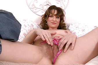 Curvy mature Misty runs her fingers down her soft body, all the way down to her moist pink bush. She rubs and fingers her hairy pussy lips until she is fulfilled.