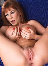 Redhead mom fingering her pussy