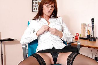Enticing cougar secretary undresses and masturbates on break