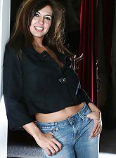 Hot and busty brunette Toni Maddux in blue denim holding her tits