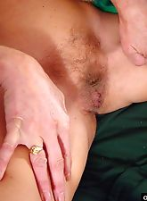 Granny slut loves playing with her naked spread pussy