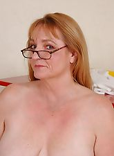Hot granny looking for young stud shows tits and spread twat