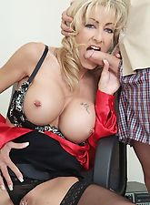 MILF boss with massive tits getting fucked in the office