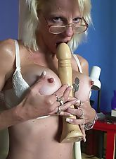 Tattooed granny shows off artwork and spread pussy