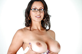Sexy cougar in glasses masturbates after reading an erotic novel