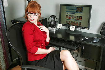 Mesmerizing red haired temp fucks a dildo while watching Anilos porn