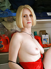 Blonde MILF gets hot doing laundry so she strips naked