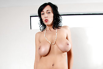 Natural milf with big tits plays with her pussy on the couch