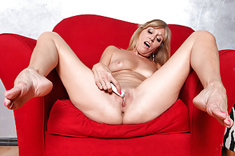 Horny blonde housewife uses a mini vibe to cum