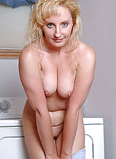 Michelle spreads her long legs on top of the washing machine