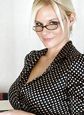 Busty blonde MILF at the office showing her pussy