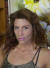 Sexy brunette MILF licks her own huge nipple